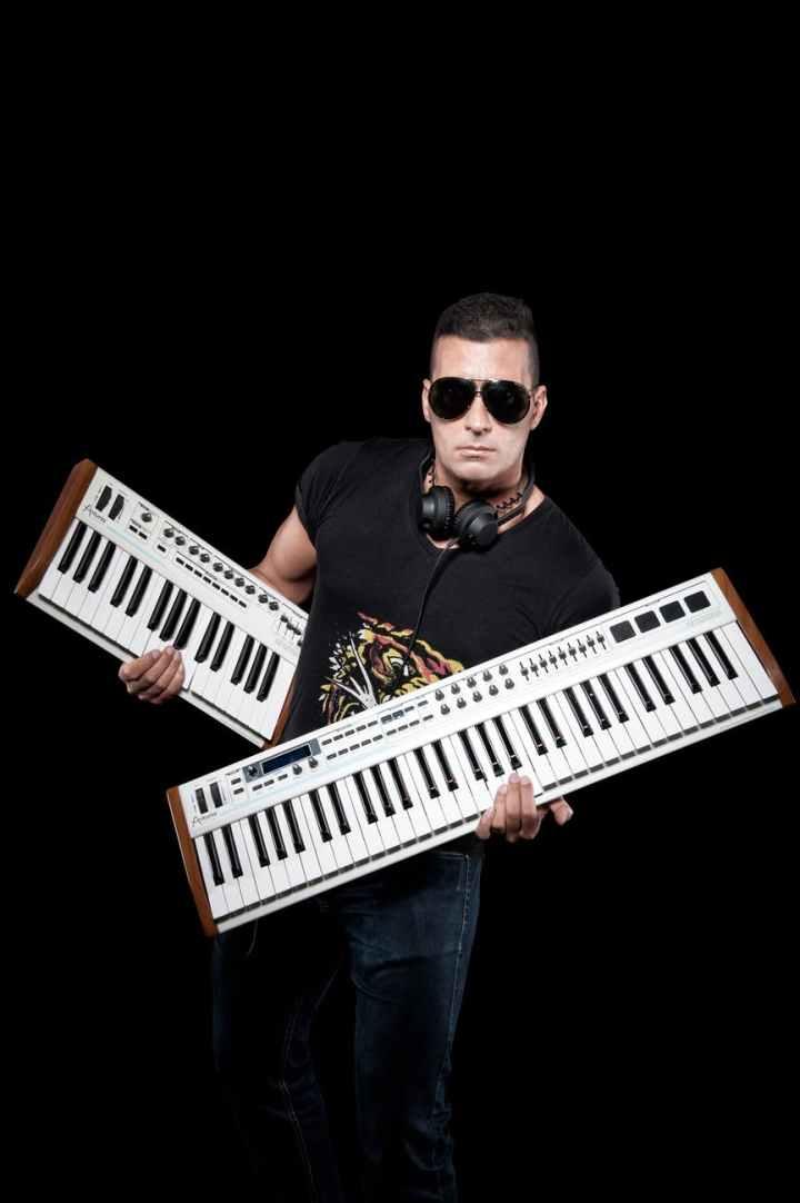 man wearing black crew neck shirt holding white keyboards